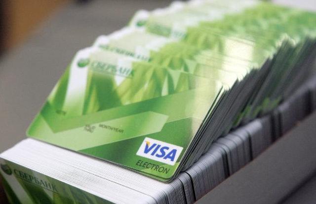 Карта Моментум от Сбербанка: условия пользования дебетовой картой, лимит кредитной карты, плюсы и минусы